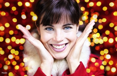 Girl wearing festive clothes and smiling
