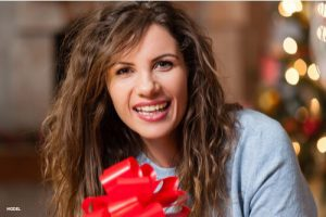 Girl holding a gift smiling