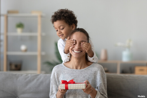 Son giving his mother a gift