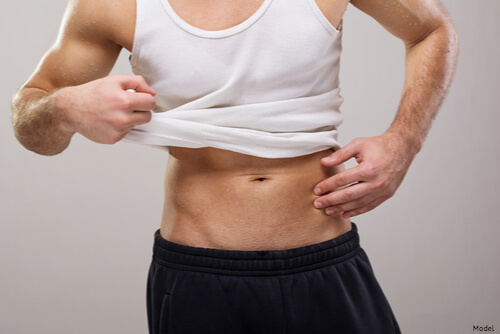Man showing abs after CoolTone session
